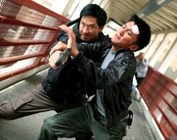 Gun in a fist fight