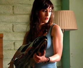 Lizzy Caplan grips the big weapon