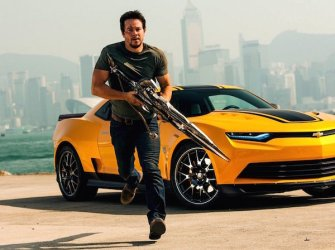 Mark Wahlberg carrying a sword that is also a gun