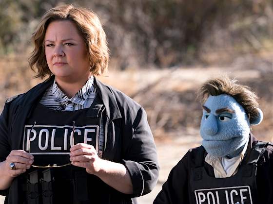 Women and puppets in blue